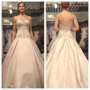 Many of Casablanca's new dresses are offered in various shades of blush pink. (Photo via Bridal Guide Magazine.)