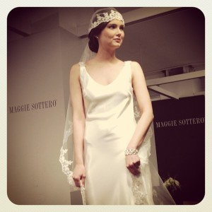 One of Maggie's many new Gatsby-influenced gowns. (Photo via Bridal Guide Magazine.)